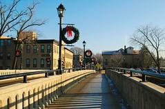 Main St. bridge over the Fox River, Carpentersville, Illinois (Cragin Spring) Tags: illinois il midwest unitedstates usa unitedstatesofamerica wreath lamppost bridge foxriver mainstreet sidewalk carpentersville carpentersvilleil carpentersvilleillinois suburb