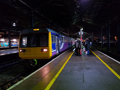Patiently waiting; northern rail. (rreyn92) Tags: pacer northern rail trains train trainstation chester people night lights platform transport uk northernrail patience spotlight old creaking mobile manchester manchesterpicadilly