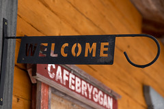 Sign (tiina.harjunpaa) Tags: welcome sign cafe building old antique village yellow log cabin outdoor winter travel fishingvillage photo photography photowalk photoart vintage finland visitfinland january canon 6dmarkii