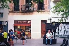 all choked up (jesuiselouise) Tags: 35mm kodak analog minoltasrt100x barcelona spain street candid city urban summer man kids lonely statue