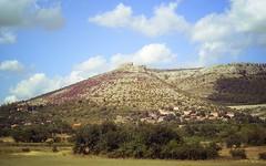Ostrovica hill (Elvis L.) Tags: ostrovica hill village rock grass tree sky cloud meadow landscape dalmatia croatia