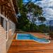 Casa de Campo do Carlos e da Erica em Santo Antônio do Pinhal, São Paulo, no Condomínio Country. Imagens da arquitetura externa, deck e piscina.