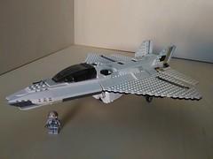 Lego Jet Fighter AFJ-S4 Arkangel (Parm Brick) Tags: lego legojetfighter stealthjet military aviation militaryaviation moc mod afol legobrick vehicle minifigure pilot jet fighter stealth modern warfare battlefield air combat aircraft