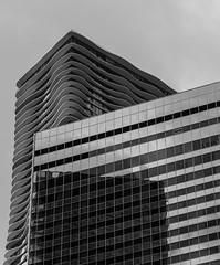 Metamorphosis (Austin Westervelt) Tags: chicago building architecture curve curves lines bw blackandwhite blackwhite monochrome city urban cityscape aqua light shadow reflection l