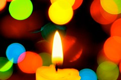 Framed in Bokeh (deanrr) Tags: macromondays holidaybokeh december242018utc holiday circles candle frame vibrant bokeh colors fire flame