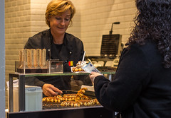Buying Waffles (llamnudds) Tags: llamnuds waffles buy purchase bruge belgium chocolate icecream shop shopkeeper customer pay