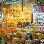 Vendor at Ben Thanh Market in Saigon offering a variety of Snacks thumbnail