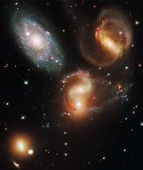 Galactic Wreckage in Stephan's Quintet (Sabri KARADOĞAN) Tags: hubble sts125 telescope nasa esa sm4 science astronomy stars galaxy galaxies spiral infrared wavelength