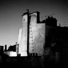 ce que la nuit manque d'atteindre (asketoner) Tags: wall building roofs paris france night pale stairs ladder climbing chimney pot antennas