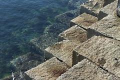 Stepping into the Ocean (PhotonArchive) Tags: seascape breakwater ogdenpoint victoriabc victoria britishcolumbia stoneblocks harbor harbour abstract pattern cubes granite sea water shoreline