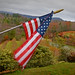 A small American flag flaps in a stiff wind at Saylor Orchard outside Bakersville in Mitchell County.