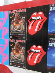 Iron Maiden with Rolling Stones Lips and Tongue Posters 5235 (Brechtbug) Tags: iron maiden concert poster blue construction fence eddie devil monster zombie album british heavy metal skeletal sidekick west 45th street nyc 2018 november 11182018 brit soldier creepy demon dude union jack flag torn billboard posters billboards cover art with rolling stones lips tongue