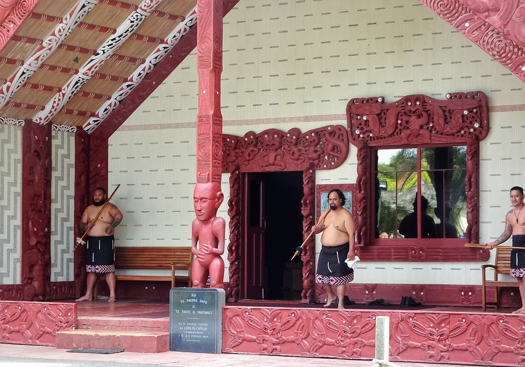 Waitangi Treaty House grounds. Maori men welcome people to the Marea.