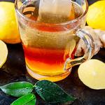 Green tea with lemon and fresh tea leaves thumbnail