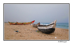 two wooden boats (harrypwt) Tags: harrypwt africa afrika togo lome canons95 s95 paintinglike boat sand coastal sea water borders framed
