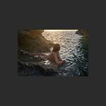 Cornish mermaid wakes with the dawn