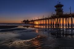 Huntington Beach Pier (Candice Staver Harris) Tags: 2018 beach california huntingtonbeach huntingtonpier longexposure nauticalimage nightphotography pacificocean pier reflection sand seascape sunset wintersunset