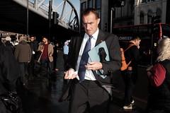 Businessman in Borough (Gary Kinsman) Tags: fujix100t fujifilmx100t fujifilmxpro1efx20 efx20 flash people person london boroughmarket londonbridge boroughhighstreet se1 businessman 2018 suit tissue candid streetphotography streetlife