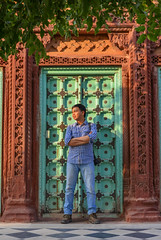 A young man standing at wooden door (phuong.sg@gmail.com) Tags: adult arms asian autumn background casual city cold confidence crossed day door entrance fall fashion green hand handsome hindu india islam looking male man men model outdoor person portrait posing rainy season serious standing street strict student sunny urban weather wooden young