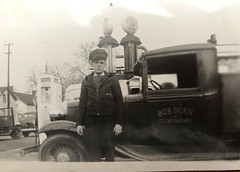 My grandma took this photo. Found it and some others. Possibly 1940's.  Love his expression, the vehicles and gas pumps. Pretty cool. (bobdunn7750) Tags: foundphotos gaspumps trucks life canada ontario stcatharines streetphotographer