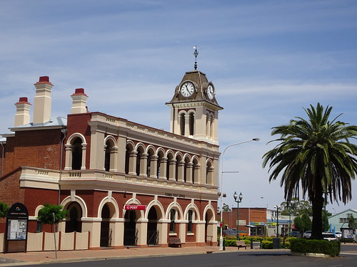 Forbes. The 1881 built Post Office with a French mansard roof on the clock tower. Government architect James Barnet designed it. Wonderful arched veranda for shade.