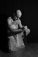 IMG_4699 CHRIS (WORLD OF FMR) Tags: warrior shooting armure silver metal canon bearded hairy tattoo man strong fit armor sword blackandwhite noiretblanc monochrome noir blanc black white wood