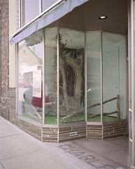 Store front, Tennessee (nikolaijan) Tags: plaubelmakina 67 plaubel kodak portra160nc 120 film tennessee johnsoncity window