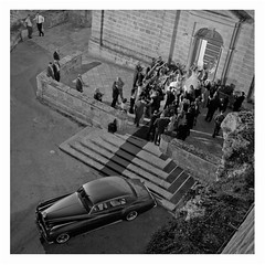 Rolls-Royce (and a newly married couple) (Anders_3) Tags: mellieha malta sanctuaryofourladyofmellieha church wedding weddingphoto blackandwhite monochrome mediterranean people nikon nightshot mellieħa bride groom marriage highangleview 7s65166v9 classiccar 3200iso rollsroycesilvercloud rollsroyce