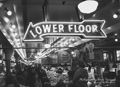 Street Scene: Pike Place Market (oterrason) Tags: streetscene street lowerfloor signage sign publicspace market pikeplacemarket publicmarket blackandwhite bw monochrome monochromatic seattle downtown sonycybershotdscw1 carlzeiss variotessart38114mmf2852