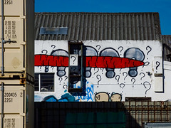So Many Questions (Steve Taylor (Photography)) Tags: vegetable carrot carrotboy questionmark graffiti mural streetart building container blue orange red black newzealand nz southisland canterbury christchurch cbd city
