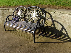 A Life On The Ocean Wave....... (Glass Horse 2017) Tags: knitted lostglove mermaid sockmonkey shadows black waves ship'swheel metal bench benchmonday valleygardens marskebythesea cleveland