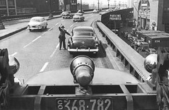"""""""Boy am I glad to see you guys!"""" A man driving southbound to work on the old elevated West Side Highway when suddenly his new Cadillac breaks down!  Today, this would back up traffic all the way to the George Washington Bridge. New York. May 1953 (wavz13) Tags: oldphotographs oldphotos 1950sphotographs 1950sphotos oldphotography 1950sphotography vintagephotographs vintagephotos vintagephotography filmphotos filmphotography oldnewyorkphotography oldnewyorkphotographs oldnewyorkphotos vintagenewyorkphotography vintagenewyorkphotographs vintagenewyorkphotos urbanphotography urbanphotos urbanscenes cityphotography oldcadillacs vintagecadillacs 1950scadillacs antiquecadillacs oldcar vintagecars 1950scar 1950scars collectiblecars collectablecars antiquecars oldcaddies vintagecadddies vintagecar oldcars manhattanhistory newyorkhistory vintagemanhattan oldmanhattan vintagenewyork oldnewyork newyorkskyscapers newyorkphotography highwayphotography newyorkphotos highwayphotos newyorkhighways traffic manhattanphotography oldsigns vintagesigns oldhighwaysigns vintagehighwaysigns cobblestones"""