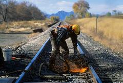 Cutting rail (Moffat Road) Tags: unionpacific up rail cutting welder mofw upmoffattunnelsub 72ndavenue arvada colorado railcutter track sparks co railsaw hardhat ppe saw