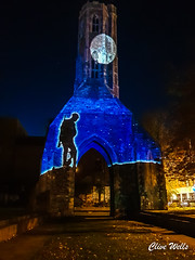 Walking soldier (wells117) Tags: grayfriars towergardens anniversary arch archway barbedwire building centenary kingslynn lightprojection lightshow lights norfolk poppy projected projection rememberance soldier tower ww1
