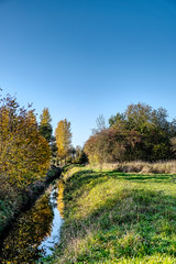Autumn Creek (enneafive) Tags: creek meadow flowing sky blue grass green reflections trees light shadow fujifilm xt2 broekbeemd wellen limburg herk