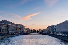 Sunset over the city (Shumilinus) Tags: 2018 35mmf18 landscape nikond300s saintpetersburgrussia architecture city sky clouds evening river riverbanks bridge skyline buildings townscape