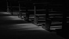 church benches (ro_ha_becker) Tags: agfaapx400 film leicacl leitzsummaron2835mm meinfilmlab münster analog wwwmeinfilmlabde stpaulusdom shadows minimal