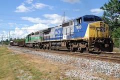 CSX7900-C40-8W_FURX3038-SD40-2_Plymouth-MI_07-13-2007a (Count_Strad) Tags: railroad track tracks emd ge gp382 c408w es44dc gp9r c449w sd40t2 plymouth melvindale northville mi michigan csx
