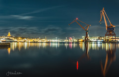 Another Night in Gothenburg (Fredrik Lindedal) Tags: gothenburg göteborg göteborgshamn cranes reflection reflections evening clouds sweden sverige city cityscape cityview lindedal lights harbor church water bridge