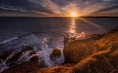 Ephemera (Impact Imagz) Tags: sunset cloudsstormssunsetssunrises sunlight sunflare waves tide rocks cliffs light gress isleoflewis outerhebrides scotland westernisles hebrides hebrideanskies hebrideanlight hebridean hebrideanseascapes irix canon