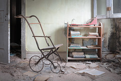 ...childs play... (Art in Entropy) Tags: abandoned mansion antiques toys child books urban exploration explore decay grime creepy room dilapidated stroller sony