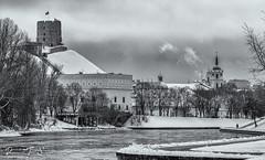 Vilnius (Prohibere Tempus) Tags: lietuva lithuania vilnius blackandwhitephotography bw canon monochrome castle winter river tower clouds sky city water building