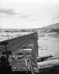 In Perspective (squirtiesdad) Tags: rockspriings wooden train trestle high desert hesperia mojave riverbed sand clouds late afternoon brush diyfilmscanning selfdeveloped universal mercury ii halfframe epson v600 blackandwhite bw analog analogue arista aristaedu iso100 35mm film
