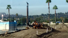 (Rich T. Par) Tags: pomona phillipsranch socal southerncalifornia losangelescounty lacounty constructionsite california palmtrees tree road suburb dirt civilengineering tubes tractor heavyequipment pipes sky backhoe backhoeloader loaderbackhoe digger drill drillingmachine drillingtruck