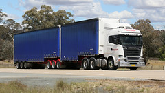 Blue & Blue (1/2) (Jungle Jack Movements (ferroequinologist) all righ) Tags: yass bowning nsw new south wales australia hume highway freeway hp horsepower big rig haul haulage freight cabover trucker drive transport carry delivery bulk lorry hgv wagon road nose semi trailer deliver cargo interstate articulated vehicle load freighter ship move roll motor engine power teamster truck tractor prime mover diesel injected driver cab cabin loud rumble beast wheel exhaust double b grunt k s scania cranston volvo