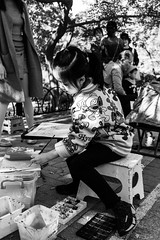 Rising star (Go-tea 郭天) Tags: qingdao shandong chine cn badaguan child kid young youth art artist painting paint seat seated sit inspiration creation creating girl small cute beautiful beauty focus sun sunny shadow brush class improvisation tools materials painter portrait street urban city outside outdoor people candid bw bnw black white blackwhite blackandwhite monochrome naturallight natural light asia asian china chinese canon eos 100d 24mm prime