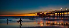 Surf City at Dusk (Greg Adams Photography) Tags: huntingtonbeach calif california southerncalifornia wharf pier pacific ocean beach surfers surf sunset dusk hhsc2000 travel sky sea silhouettes people 2014
