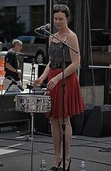 She Drums & Sings (Scott 97006) Tags: woman musician singer performer concert snare sticks pretty skirt
