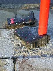 Welly post (Nekoglyph) Tags: wellies boots lost forgotten childrens spotted pole pink red black pavement coatham redcar cleveland green white blue