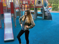 Girl Posing at Playground towards the Camera (Jonatan Svensson Glad (Josve05a)) Tags: cute child happy smiling people smile sitting caucasian happiness looking childhood kid women person human pretty cheerful fun joy outdoors youth play playful playing outdoor children activity kids playground younggirl 14years